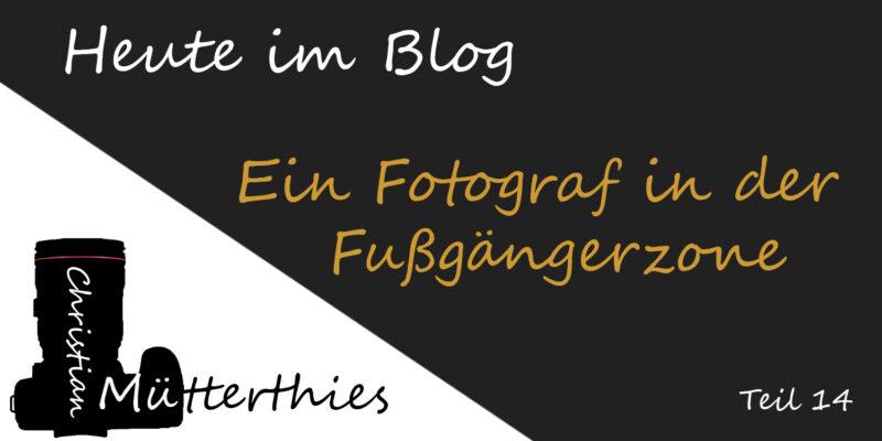 (14) Ein Fotograf in der Fußgängerzone